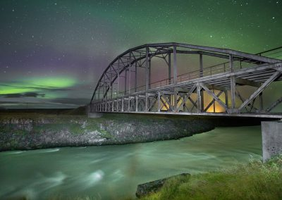 Aurora Borealis with the old bridge over river Þjórsá